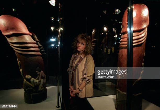 A Woman Viewing Erotic Sculpture from the Beate Uhse ErotikMuseum in Berlin
