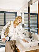 Woman viewing sink in design showroom
