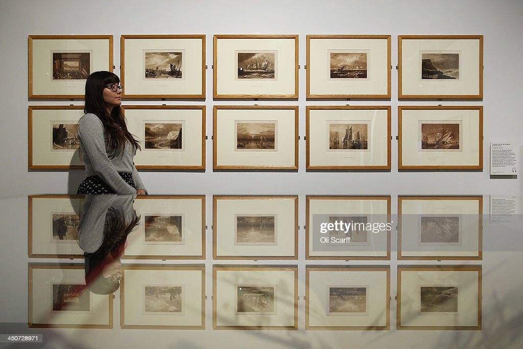 A woman views 10 plates from the 'Liber Studiorum' by J.M.W. Turner in the exhibition 'Turner & the Sea' at the National Maritime Museum on November 20, 2013 in Greenwich, England. The exhibition, which opens on November 22, 2013 and runs until April 21, 2014, brings together 120 works of art by the great British painter of the sea.