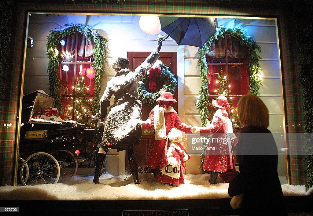 A woman views a Christmas display outside the Bergdorf Goodman store December 4 2001 in New York City New York is in full holiday swing as the city...