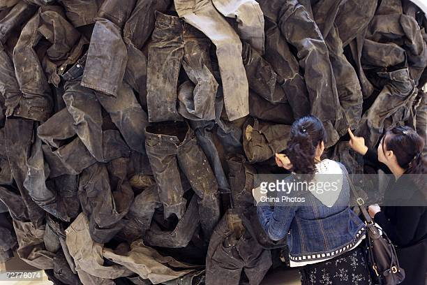 A woman views a huge ball formed by about 100 Calvin Klein jeans on December 8 2006 in Nanjing of Jiangsu Province China The decoration has become an...
