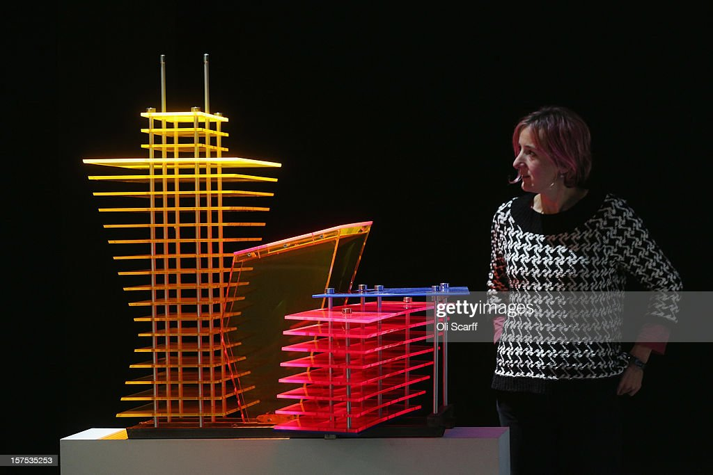 A woman views a maquette for the Fourth Plinth proposal by Thomas Schutte entitled 'Model for a Hotel' which features in the exhibition 'Fourth Plinth: Contemporary Monument' at the ICA on December 4, 2012 in London, England. The exhibition at the Institute of Contemporary Arts features maquettes by artists including Tracy Emin, Antony Gormley, Anish Kapoor, it opens tomorrow and runs until January 20, 2013.