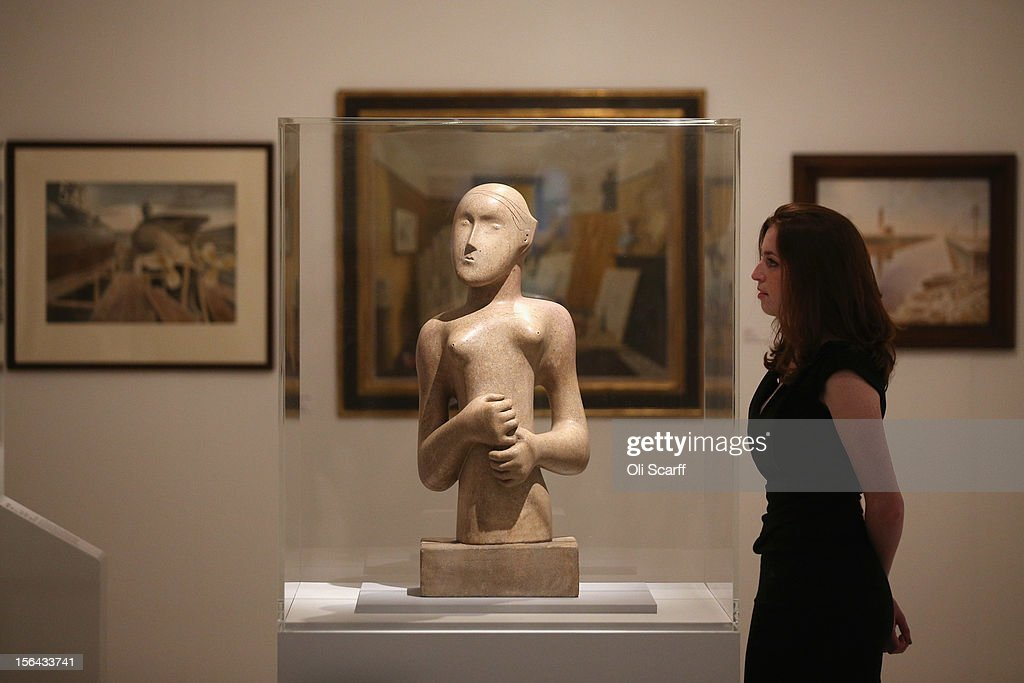 A woman views artwork by Henry Moore entitled 'Girl' in the 'Perfect Place to Grow' exhibition at The Royal College of Art in celebration of their 175th anniversary on November 15, 2012 in London, England. The Royal College of Art's major exhibition, 'The Perfect Place to Grow', features over 350 works of art and design by RCA graduates and staff including: Henry Moore, Tracey Emin and David Hockney. The RCA is the world's oldest art and design university in continuous operation and it currently educates 1,200 postgraduate students from 55 different countries.