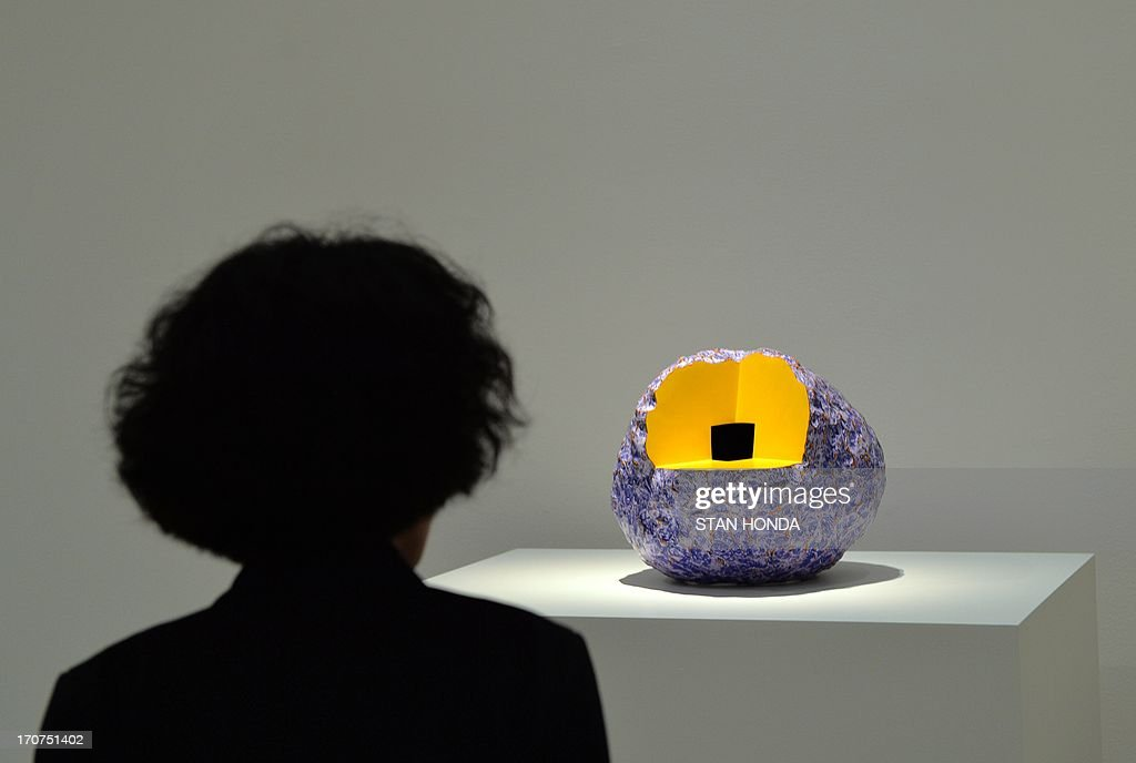 A woman views 'Big Load, 1988' by artist Ken Price during a preview of 'Ken Price Sculpture: A Retrospective' June 17, 2003 at the Metropolitan Museum of Art in New York. AFP PHOTO/Stan HONDA