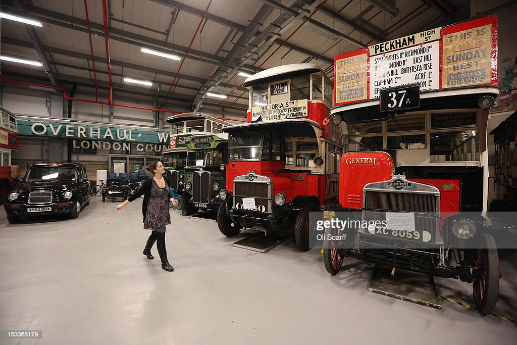 A woman views conserved buses and taxis in the London Transport Museum Depot in Acton prior to its open weekend on October 4, 2012 in London, England. The museum depot, which houses over 400,000 objects, will open its doors to the general public this weekend, October 6 and October 7, 2012. Artifacts throughout the ages include historic road and rail vehicles, thousands of posters and artworks, signage, engines, models, uniforms and ticket machines.