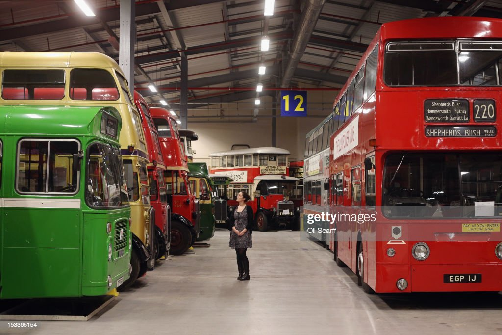 A woman views conserved buses in the London Transport Museum Depot in Acton prior to its open weekend on October 4, 2012 in London, England. The museum depot, which houses over 400,000 objects, will open its doors to the general public this weekend, October 6 and October 7, 2012. Artifacts throughout the ages include historic road and rail vehicles, thousands of posters and artworks, signage, engines, models, uniforms and ticket machines.