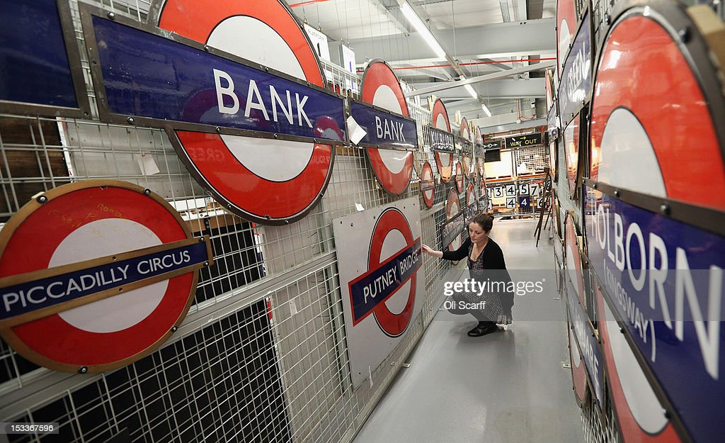A woman views conserved platform nameplate signs in the London Transport Museum Depot in Acton prior to its open weekend on October 4, 2012 in London, England. The museum depot, which houses over 400,000 objects, will open its doors to the general public this weekend, October 6 and October 7, 2012. Artifacts throughout the ages include historic road and rail vehicles, thousands of posters and artworks, signage, engines, models, uniforms and ticket machines.