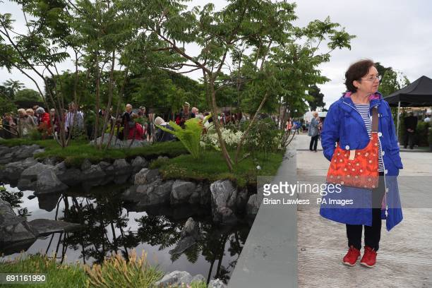 A woman views one of the show gardens at the Bloom festival in Dublin's Phoenix Park