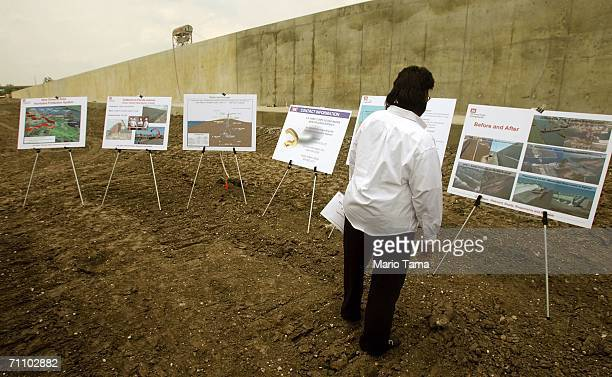A woman views plans laid out at the rebuilt levee which was breached by Hurricane Katrina along the Industrial Canal in the Lower Ninth Ward June 1...