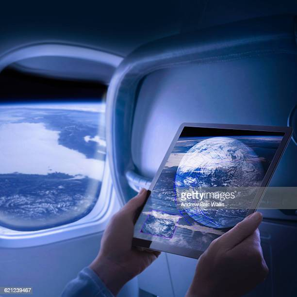 Woman views screen data on passenger space flight