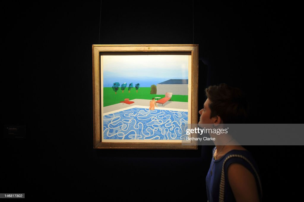 A woman views 'Swimming Pool' by David Hockney at Sotheby's on June 14 2012 in London England This piece is part of the Impressionist Modern and...