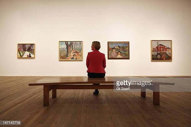 A woman views the exhibition 'Edvard Munch The Modern Eye' in the Tate Modern gallery on June 26 2012 in London England The major exhibition of...