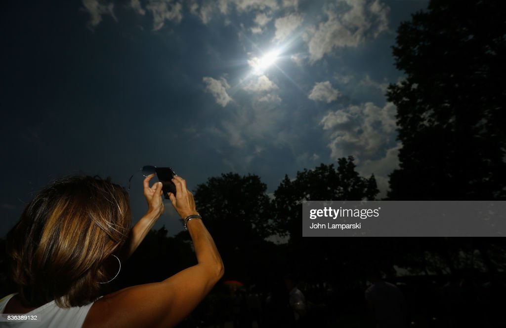 A woman views the solar eclipse at Battery Park on August 21, 2017 in New York City.