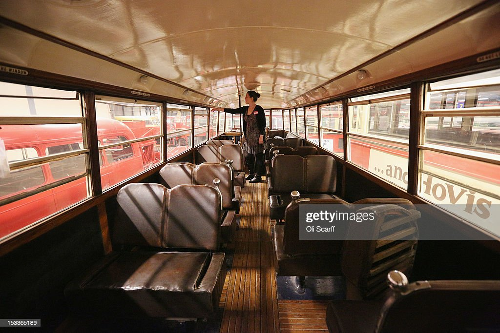 A woman views the upper deck of a conserved tram in the London Transport Museum Depot in Acton prior to its open weekend on October 4, 2012 in London, England. The museum depot, which houses over 400,000 objects, will open its doors to the general public this weekend, October 6 and October 7, 2012. Artifacts throughout the ages include historic road and rail vehicles, thousands of posters and artworks, signage, engines, models, uniforms and ticket machines.