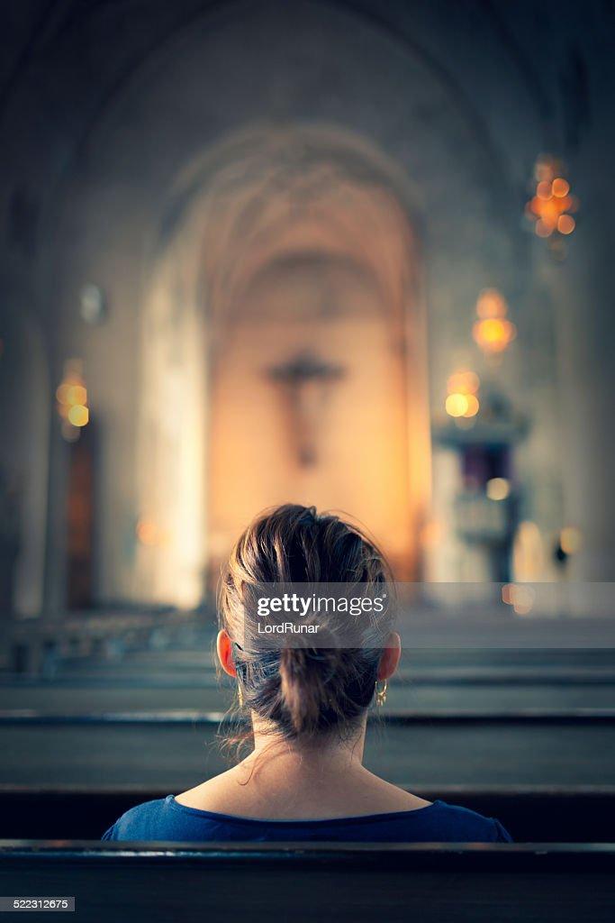 Woman visiting a christian church : Stock Photo