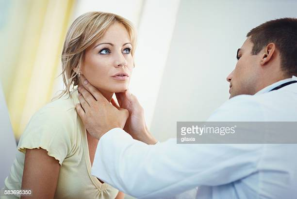 Woman visiting a doctor.