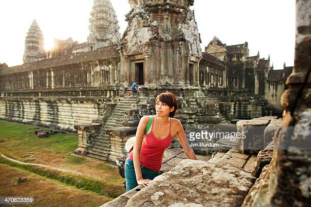 Woman visiting ancient temple, Angkor, Siem Reap, Cambodia