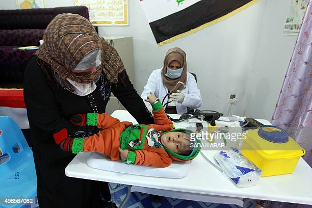 A woman visits a doctor with her baby in a clinic run by the nongovernmental medical humanitarian organisation Medecins Sans Frontieres or Doctors...