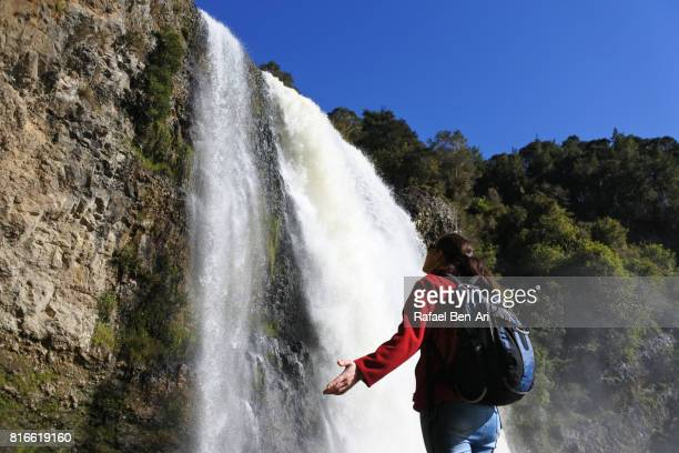 Woman visits at Hanua Falls New Zealand