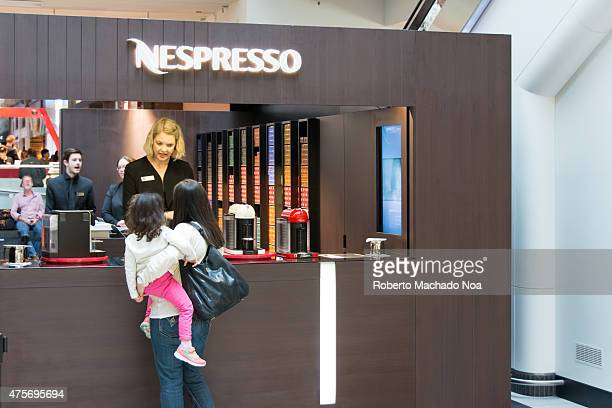 Woman visits Nespresso kiosk while visiting the mall with her daughter