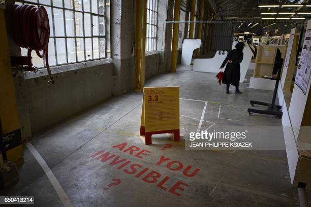 A woman visits the 10th SaintEtienne International Design Biennial on March 9 2017 at the SaintEtienne Cite du Design site formerly the Arms...