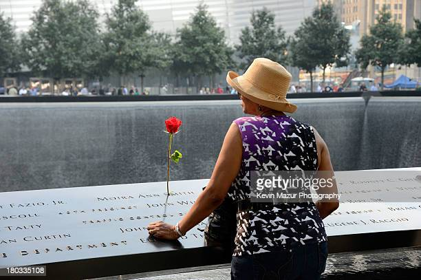 A woman visits the 9/11 Memorial on the twelfth anniversary of the terrorist attacks on lower Manhattan at the World Trade Center site on September...