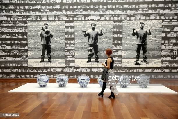 A woman visits the 'Ai Weiwei on Porcelain' exhibition after the a press conference that held by Ai Weiwei the most famous Chinese artist Suzan...