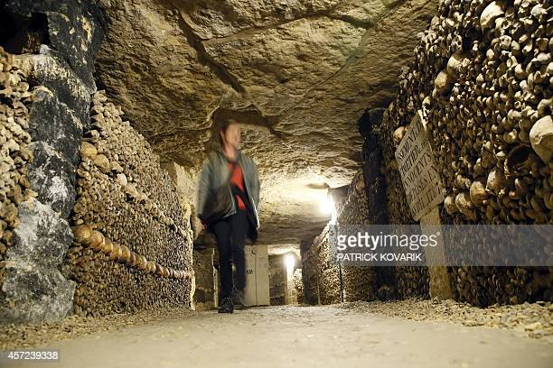 A woman visits the Catacombs of Paris on October 14 2014 These underground quarries were used to store the remains of generations of Parisians in a...