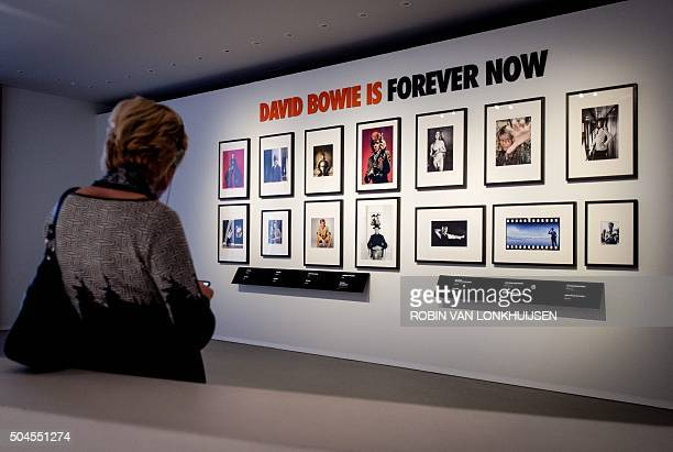 A woman visits the exhibition David Bowie Is at the Groninger Museum in Groninger on January 11 2016 The British music legend David Bowie has died at...