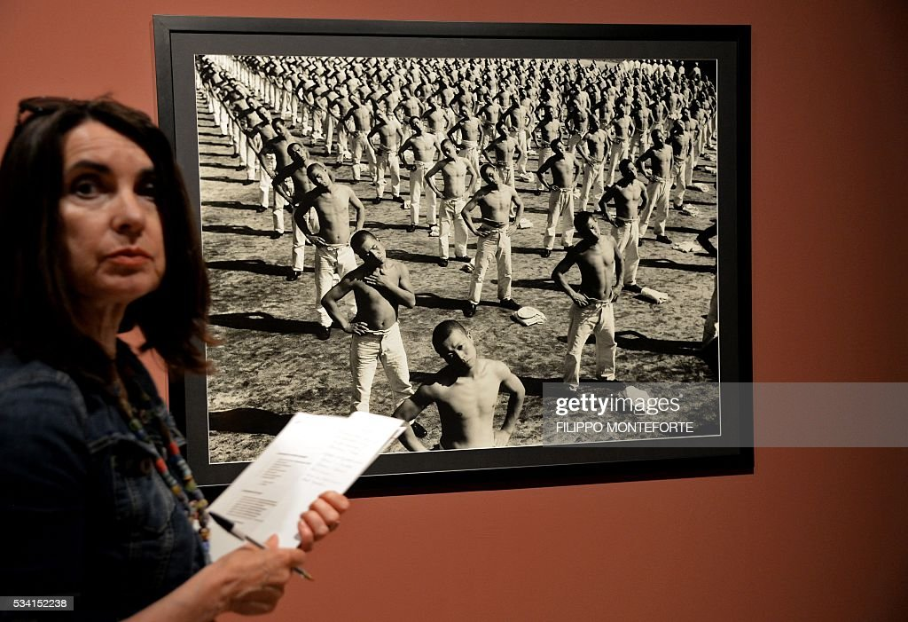 A woman visits the exhibition of Japanese photographer Domon Ken (1909-1990) during a press preview at the Ara Pacis Museum (Museo dell'Ara Pacis) on May 25, 2016 in Rome. The show will run from May 27, 2016 to September 18, 2016 to mark 150th years of friendship between Japan and Italy. / AFP / FILIPPO
