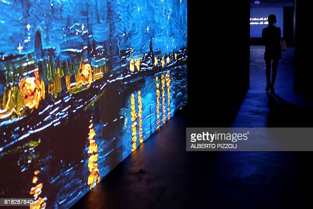 A woman visits the exhibition 'Van Gogh Alive The Experience' life and work of Vincent Van Gogh from 1880 until 1890 on October 26 2016 in Rome...