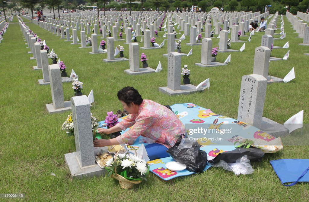 A woman visits the grave of her relative who died during the Korean War at Seoul National Cemetery on June 6, 2013 in Seoul, South Korea. South Korea today marks the 58th anniversary of the Memorial Day for those killed in the 1950-53 Korean War.