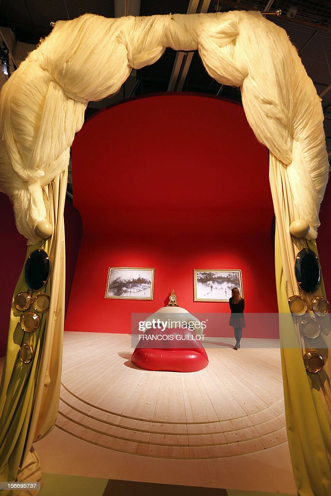 A woman visits the 'Rita Mae West room' designed by Spanish surrealist artist Salvador Dali during an exhibition devoted to his work at the Centre Pompidou contemporary art center (aka Beaubourg) on November 19, 2012 in Paris. More than 30 years after the first retrospective in 1979, the event gathers more than 200 art pieces and runs until March 13, 2013. AFP PHOTO FRANCOIS GUILLOT