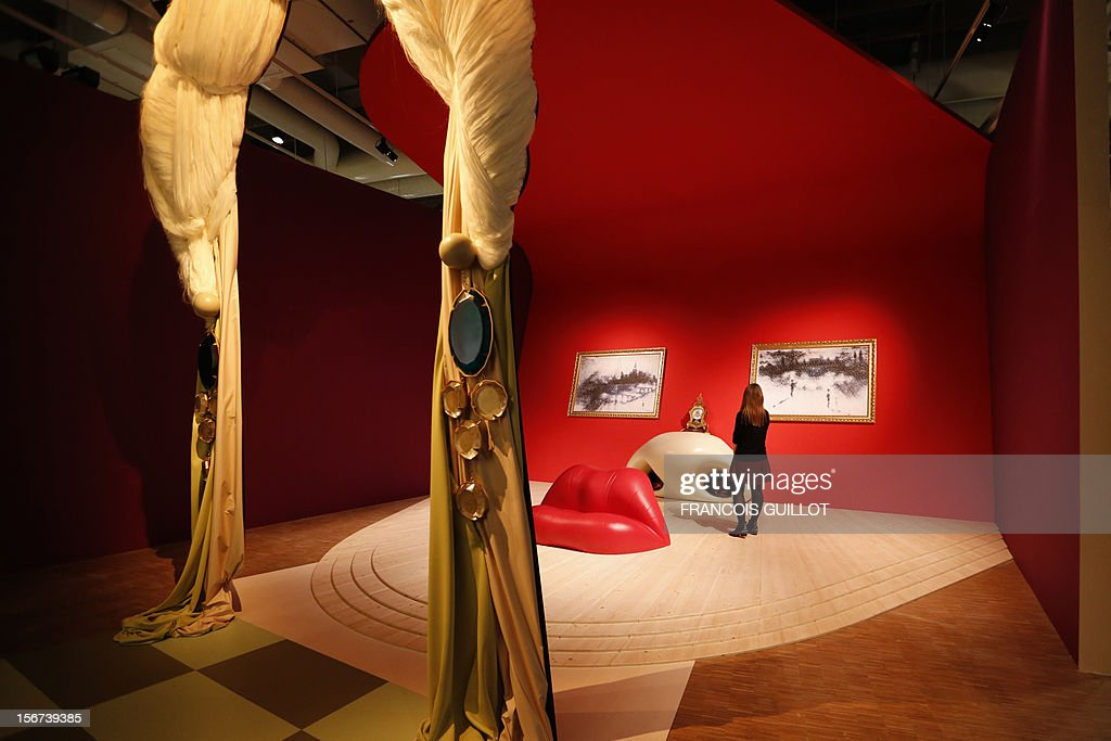 A woman visits the 'Rita Mae West room' designed by Spanish surrealist artist Salvador Dali during an exhibition devoted to his work at the Centre Pompidou contemporary art center (aka Beaubourg) on November 19, 2012 in Paris. More than 30 years after the first retrospective in 1979, the event gathers more than 200 art pieces and runs until March 13, 2013.