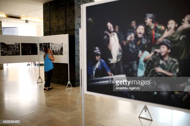 A woman visits the World Press Photo 2014 exhibition displaying award winning snapshots of photojournalists from around the world at Forum Istanbul...
