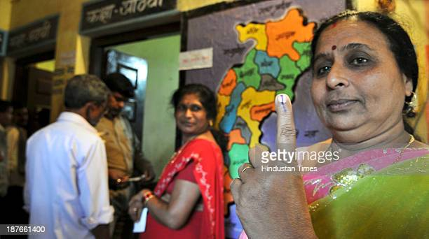 A woman voter showing her mark after cast her vote at polling booth during the first phase of assembly elections of Chhattisgarh at Jagadalpur on...