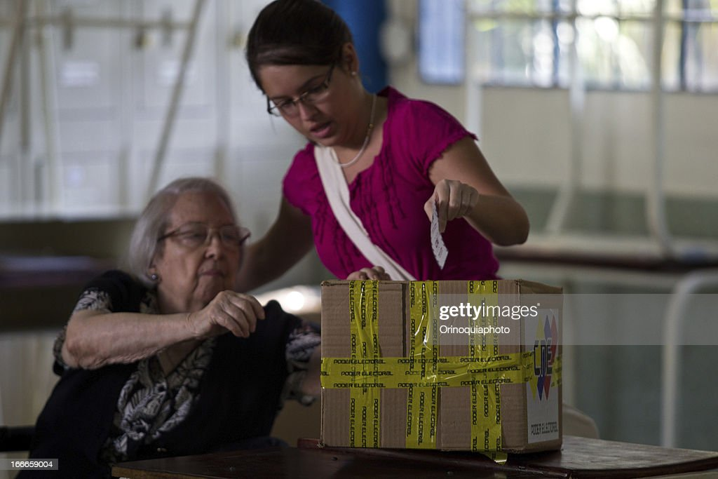 A woman votes at a polling center in the east of the city, in the Colegio Don Bosco de la Castellana on April 14, 2013 in Caracas, Venezuela.