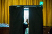 A woman votes at a polling station in Chelsea on September 10 2013 in New York City Registered voters in New York are voting today in the Democratic...