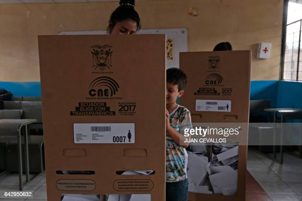 A woman votes at a polling station in Guayaquil during Ecuador's general elections on February 19 2017 Ecuador's elections will decide who succeeds...
