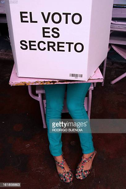A woman votes at a polling station in Quito on February 17 2013 Ecuadoreans began voting Sunday in national elections in which President Rafael...