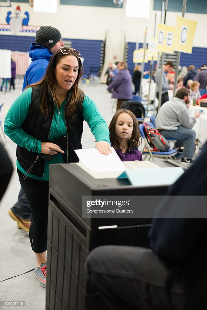 A woman votes at the Londonderry High School in the 2016 New Hampshire primaries in Londonderry, NH on February 9, 2016.
