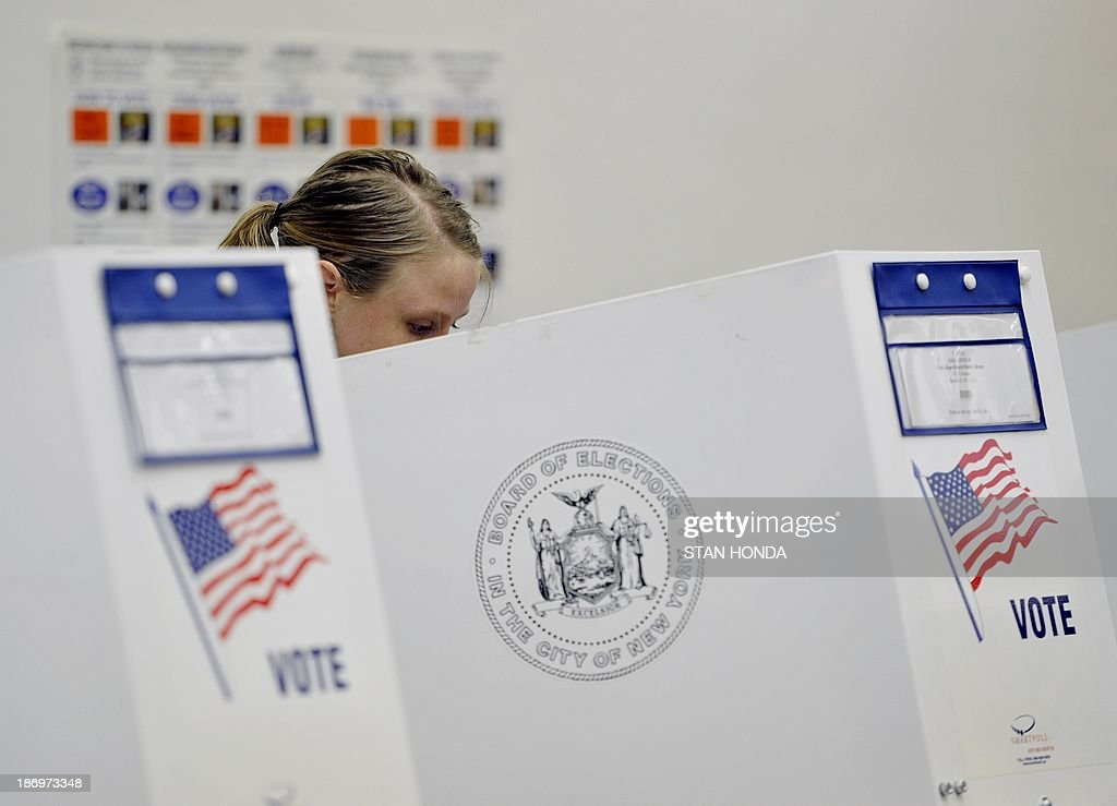 A woman votes at the Park Slope Branch Public Library in the Brooklyn borough of New York November 5, 2013. AFP PHOTO/Stan HONDA