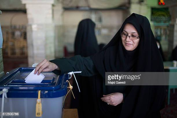 A woman votes in the parliamentary and Experts Assembly elections at a polling station on February 26 2016 in Qom 125 kilometers south of the capital...