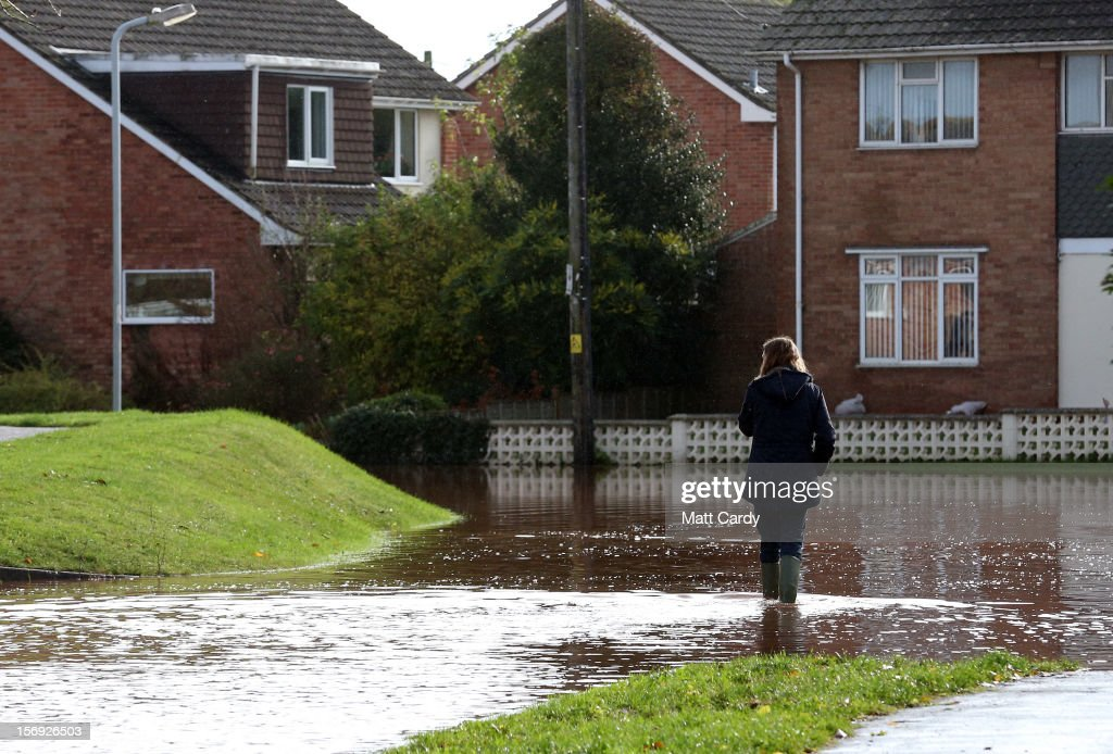 A woman wades through flood water in the centre of the village of Ruishton, near Taunton, on November 25, 2012 in Somerset, England. Another band of heavy rain and wind continued to bring disruption to many parts of the country today particularly in the south west which was already suffering from flooding earlier in the week.