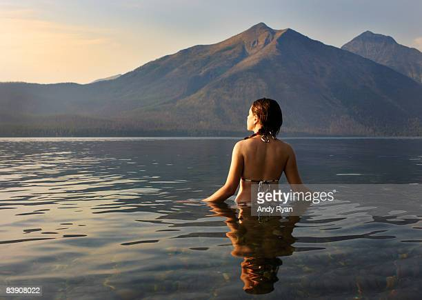 Woman wading in lake