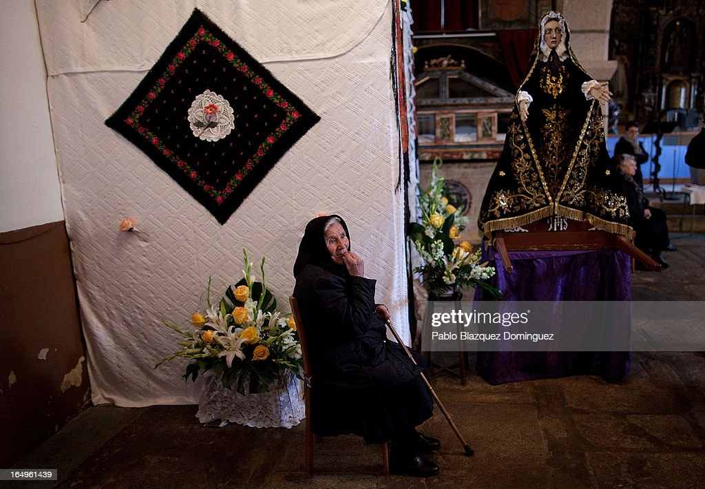A woman wait for the start of the Holy Week procession of the Cofradia of Santo Entierro brotherhood inside the church on March 29, 2013 in Bercianos de Aliste near Zamora, Spain. The procession was finally stopped because of the rain. Easter week is traditionally celebrated with processions in most Spanish towns.