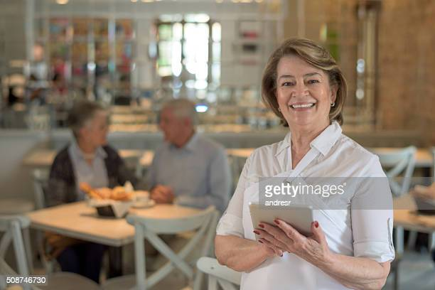 Woman waiter working at a restaurant