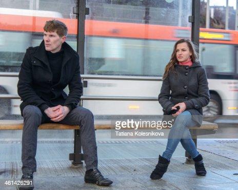 Woman waiting at bus station