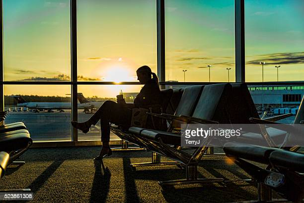 Woman Waiting for Her Flight Early Morning