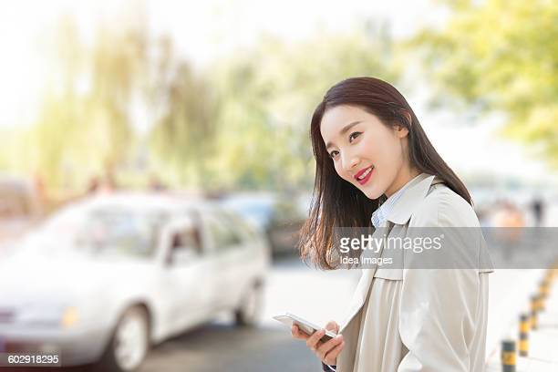 Woman waiting for Uber in the street